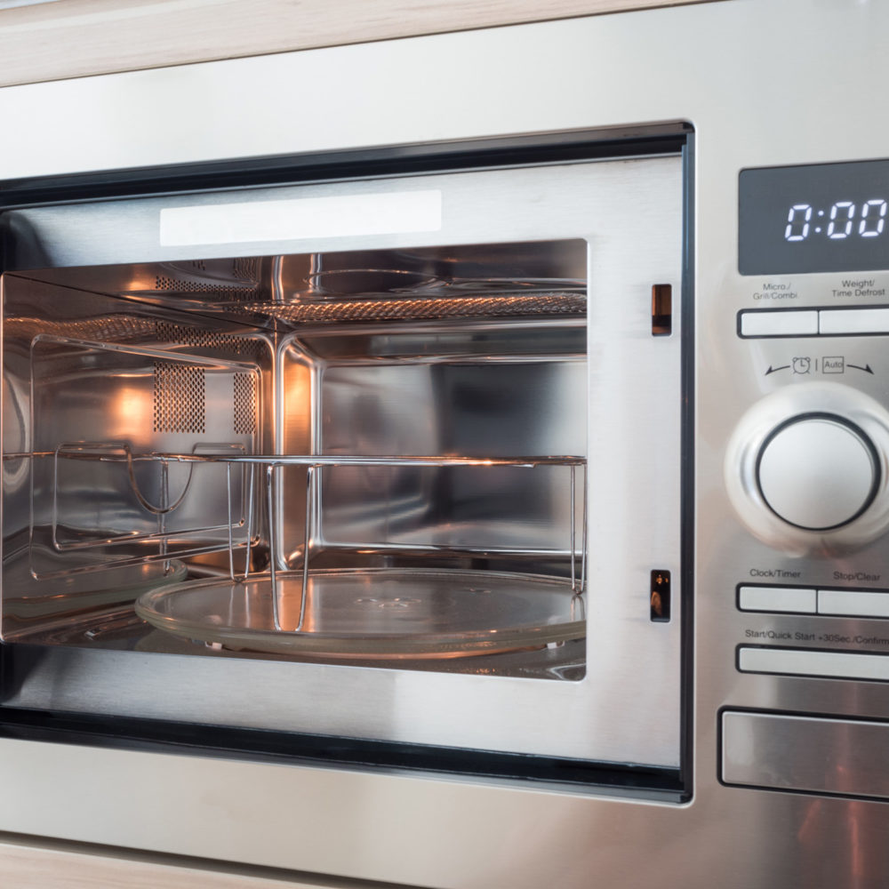 Microwave with timer clock in kitchen